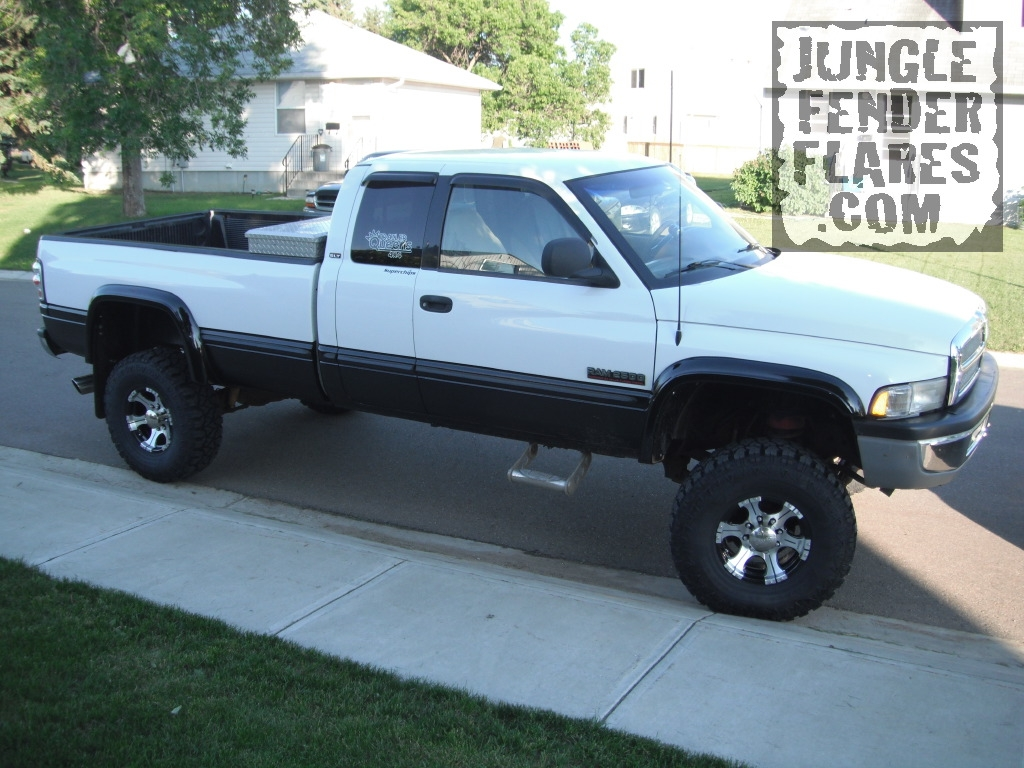 1998 dodge ram with lift kit and wheel flares